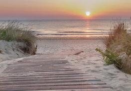 Strand fotobehang Avondzon